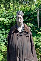 Lifelike Male scarecrow wearing waxed jacket, Golf Course Allotments, London, UK.