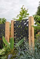 Decorative screens with oak posts  - 'Jungle Fever', RHS Tatton Park Flower Show, 2018.