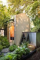 The Viking Cruises Wellness Garden: Sauna in the garden with metal plunge pool. Sponsor: Viking Cruises, RHS Chelsea Flower Show, 2018.