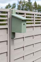Bird box fixed on to fence