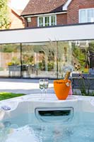 Hot tub with Champange and view to modern extension