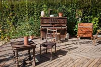 Old furniture, chairs, tables, dresser and piano, an allegory of Marcel 