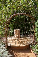Wooden seat in wicker cage. Dans Ma Bulle, In My Bubble. Garden of Thought.  Festival des Jardins 2018, Chaumont sur Loire, France