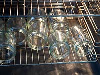 Warming glass jam jars in oven.