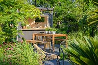 Metal shed with Dining Table,'B and Q Bursting Busy Lizzie' Garden, RHS Hampton Flower Show, 2018