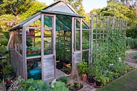 View of traditional wooden greenhouse. Mill House, Netherbury, Dorset, UK.