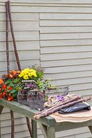 Materials and tools for making a vertical hazel planter.