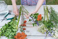 Selecting flowers and tying a bouquet