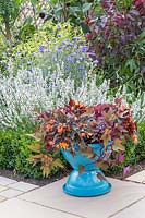 Bird bath with Begonia 'Fireworks' and Ipomoea planting