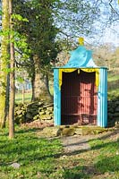 The Pagoda, a metal shelter in the shape of a small tent in the woods above Plas Brondanw, Penrhyndeudraeth, Gwynedd, Wales