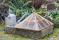 Old glass cloche, trough and watering can.