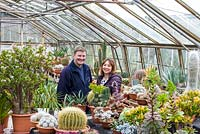Daniel and Joanne Jackson with mature succulents and cacti, at Ottershaw Cacti.