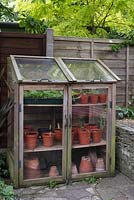 Small greenhouse in town garden.