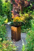 Bird bath of oak sleeper pedestal and mild steel bowl.