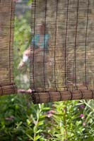 Detail of modern wicker screen in garden.