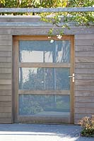View of timber and glass door of new wooden shed