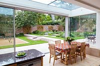 View from the dining room out to the patio and garden. Garden designed by Peter Reader Landscapes.