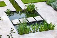 Overview of formal pond and stepping stones.. Garden design by Peter Reader Landscapes.