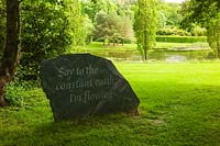 Slate stone carved with quotation from the poet Rilke. Plaz Metaxu Garden, Devon, UK.