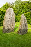 Delabole slate standing stones within a Hornbeam hedge enclosure. Plaz Metaxu Garden, Devon, UK.