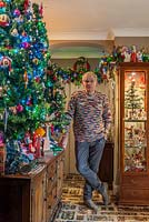 Portrait of Geoff Stonebanks, surrounded by Christmas decorations.