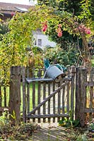 Garden gate with watering can.