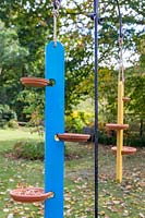 Hanging multi-feed bird tables.
