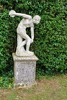 Reproduction of a classical sculpture inside a maze of privet hedges that provides protection from prevailing winds