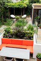 View of modern, multi-level garden with sunken seating area.