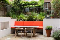 View of sunken seating area in multi-level contemporary garden.