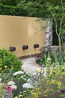 Yellow wall with water spouts. Daily Telegraph Garden, RHS Chelsea Flower Show, 2011.