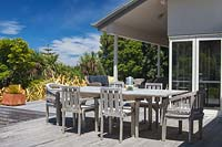 Table and chairs on veranda at Fishermans Bay Garden, New Zealand