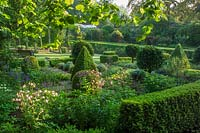 Formal parterre with Buxus hedging, shaped topiary spheres and standards, Bickham House, Devon, UK.