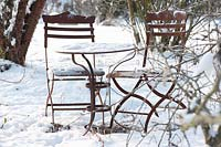 Small seating area in snowy garden