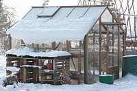 Greenhouse covered with snow