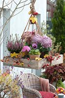 Hanging arrangement with heather and chrysanthemums