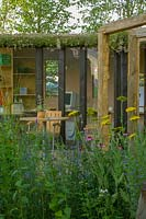 Outdoor office and seating area in show garden. Hampton Court Flower Show 2003, London, UK.