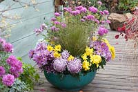 Large bowel planted with chrysanthemums and ornamental grass.