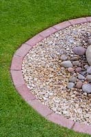 Lawn with brick edging, gravel and pebbles