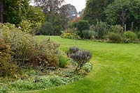 Autumn borders and curved lawn, Hertfordshire, UK