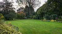 Lawn and borders at Thundridge Hill House Garden, Hertfordshire, UK