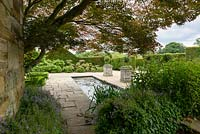 Paved Garden with pond and stone planters