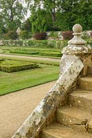 View from stone steps to South Lawn in formal garden, Penshurst Gardens, Kent, UK.