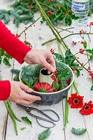 Woman adding Ilex to bundt cake tin.
