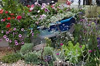 Old boat with bedding plants, 'Fun On Sea' Southend-on-Sea garden, Hampton Court Palace Flower Show, 2017