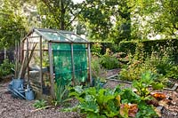 Vegetable garden with small greenhouse.