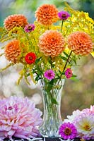 Summer flowers in a vase including Dahlia, Solidago and Zinnia elegans.