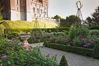 View of castle from formal Rose Garden, with decorative sundial. Arundel Castle, West Sussex, UK.