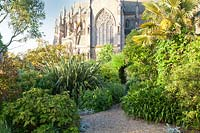Pathway in walled garden with Cathedral beyond. Arundel Castle, West Sussex, UK.