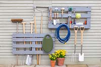Pallet storage organiser, split painted pallet used for storing tools and gardening equipment